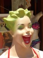 laugh mannequin face red crown