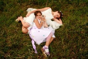 Happiness of two sisters in white dresses