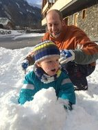 child father snow play