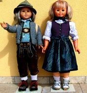 smiling boy and girl dolls