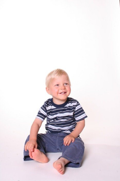 photo of a child in a striped T-shirt