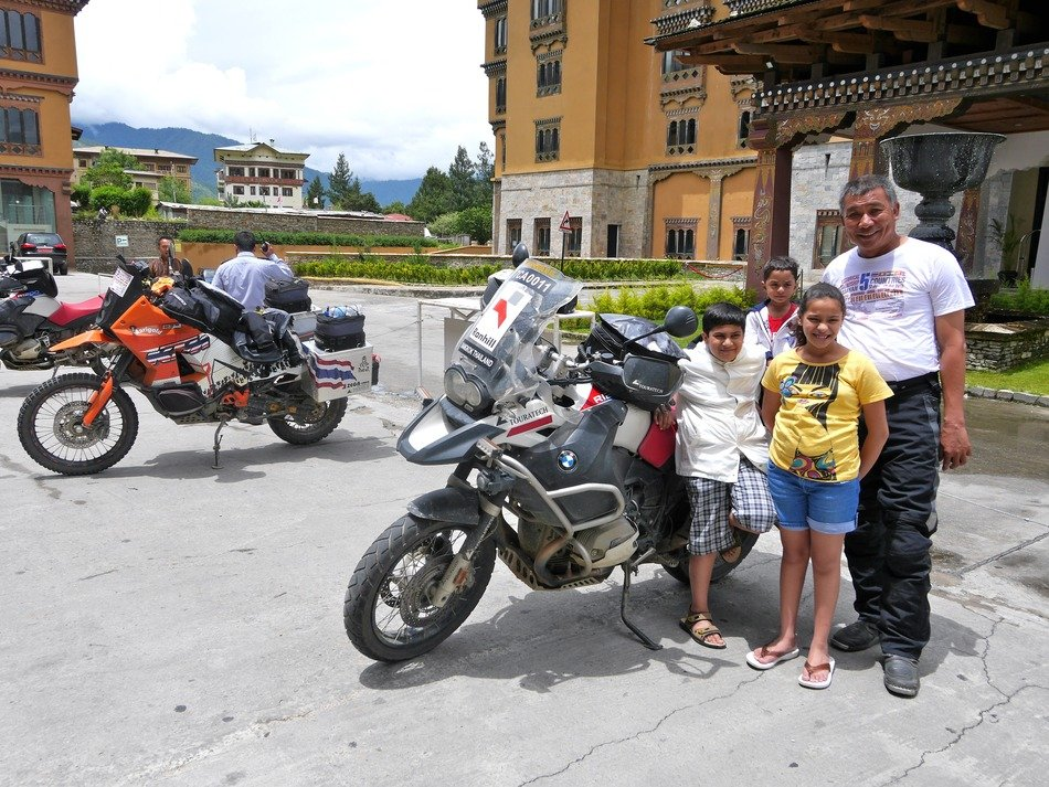 thai family with bikers