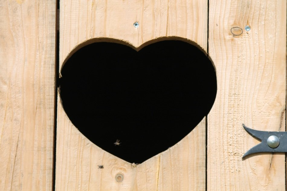 hole in the form of heart on a wooden door