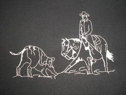 drawing of a rider on a horse near a wolf on a black background