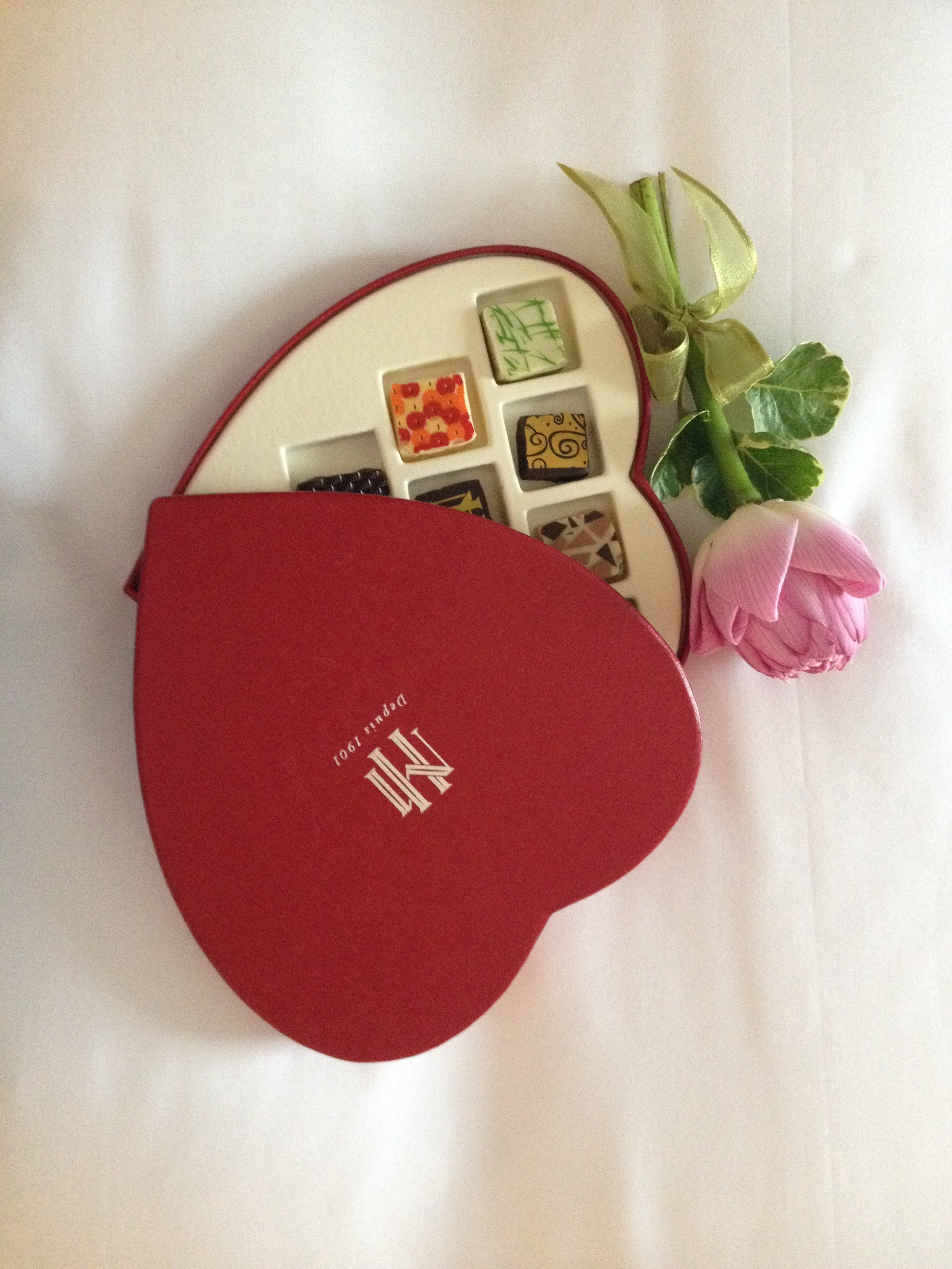 Chocolates In Red Box And Lotus Flower Free Image