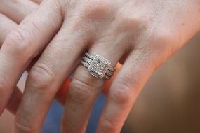 engagement ring with diamonds on the hand