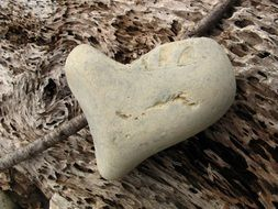 heart form stone on wooden background