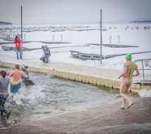 winter swimmer coming into the cold water
