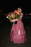 woman in a ball gown with flowers bouquet