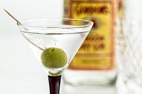 cocktail with martini and olive