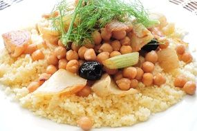 couscous dish with beans, meat and olives