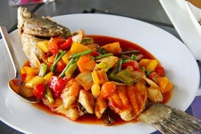 fried spicy fish with sweet and sour asian cuisine sauce