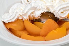 canned apricot with whipped cream