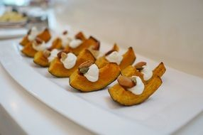 sweet pumpkin with sour cream and nuts