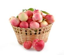 braided basket with pinky-red apples