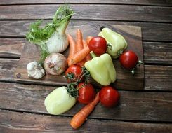fresh organic vegetables on wooden table