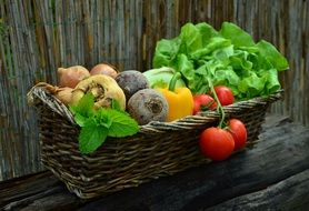 wooden basket with fresh juicy vegetables