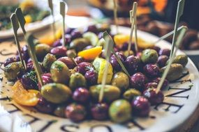 green and black olives on a plate