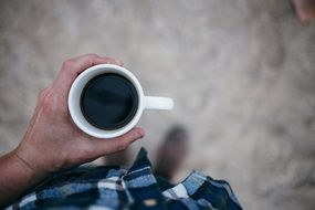 black coffee in male hands