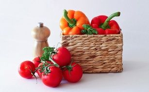 tomatoes and paprika in a basket