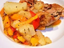 roasted chicken with potatoes and spices