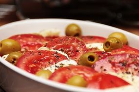 tomatoes with mozzarella and olives