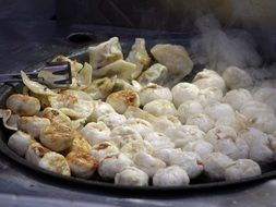 Chinese dumplings in a large pan