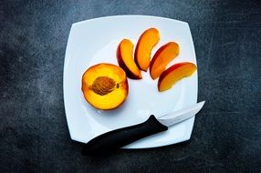 peach snack fruit food healthy Knife white plate