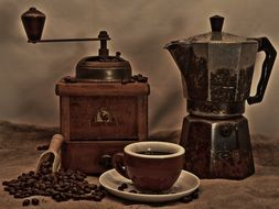 coffee grinder, coffee maker and cup of coffee