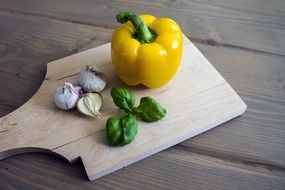 Yellow paprika and garlics and basil