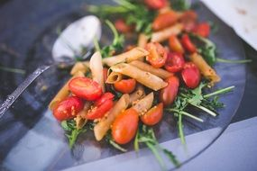 Pasta with rucola,tomatoes and souce
