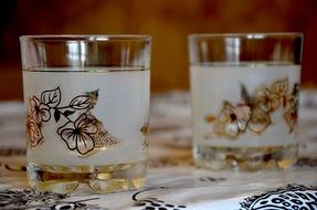 ornamented glasses on table