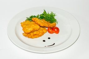 fried chicken chops on a white plate