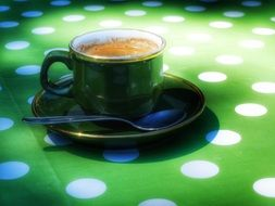 cup of coffee on a saucer on a table