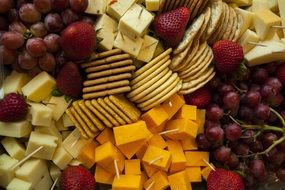 cheese plate with crackers and fruits