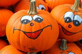 happy faces, painting on pumpkins