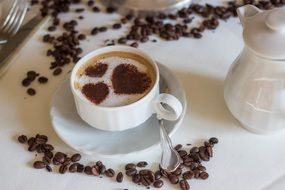Cup of coffee with hearts on foam