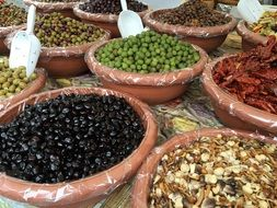 a variety of olives at the local farmers market in Italy