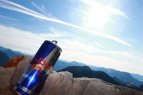 energy drink in the sunlight among the mountains