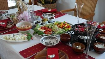 Fondue and other snacks on a table