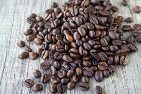 roasted coffee beans on a gray surface