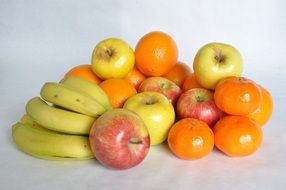 fruit mix with bananas, tangerines and apples