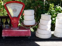 cheese heads on vintage weigh scale outdoor
