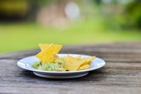 snack nachos guacamole on grey table