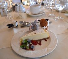 cheesecake and toys on banquet table