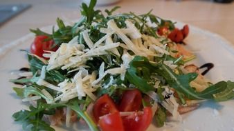delicious salad with arugula parmesan and tomatoes