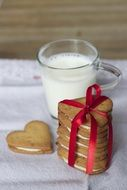 glass of milk and heart shaped cookies for valentines day