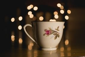cup with a drink on the background of lights