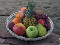 still life fruits pineapple apricots tropical fruits