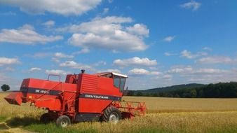 red combine harvester on the field